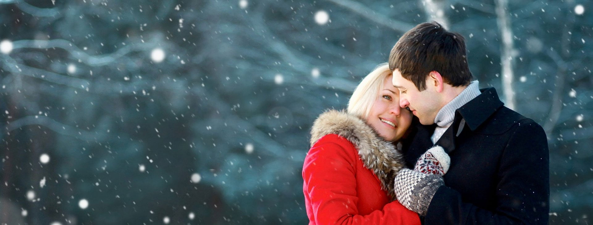 Couple in the snow using Sunsafe Rx sunscreen pills