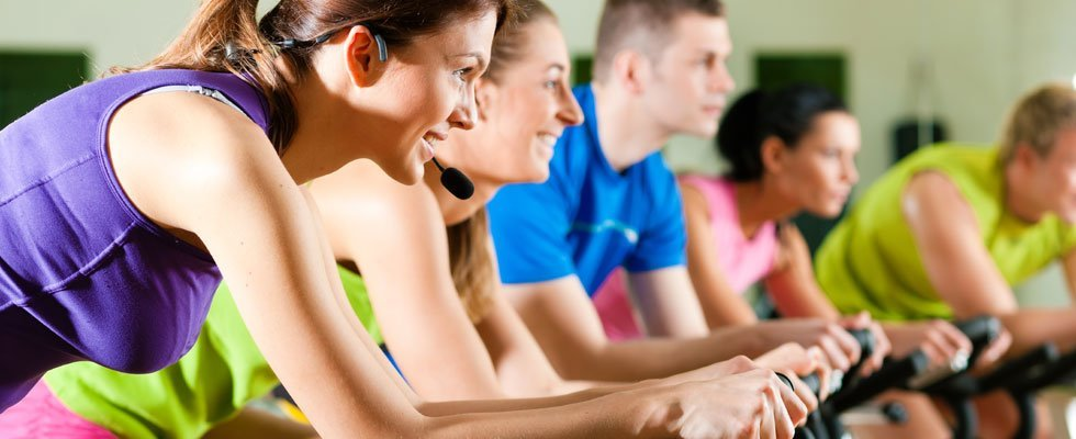 Stationary Bicycle Group Fitness Class With Women And Men