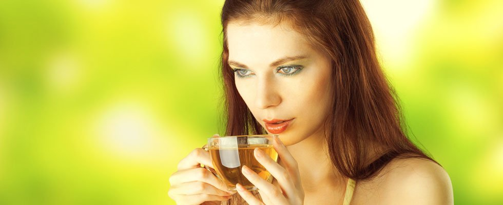 Woman Drinking Green Tea For Health Benefits