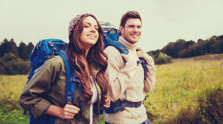Woman and man hiking using sun protection pill