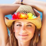 Woman with solar urticaria in sun wearing hat